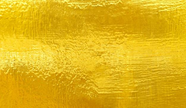 Abstrait de texture en acier métal poli or.