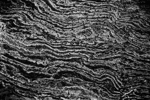 Abstrait de la texture du marbre noir en lumière naturelle.