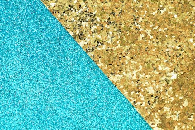Abstrait et texture de matériau brillant bleu et brillant d'or avec un grand fond de paillettes.