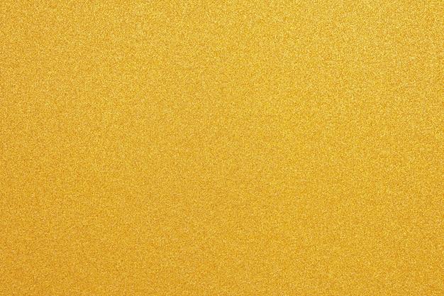 Abstrait de texture de paillettes d'or surface jaune brillant