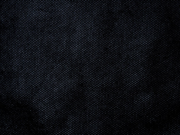 Abstrait de texture de tissu noir abstrait avec un espace vide pour la conception.
