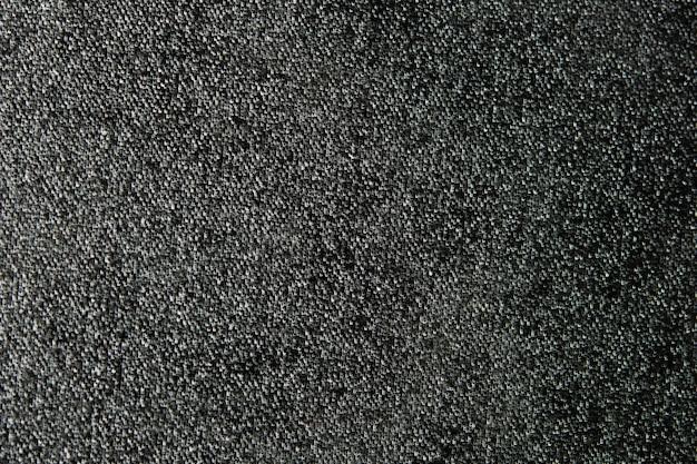 Abstrait de texture de toile noire avec un espace vide pour ajouter du texte et un design décoratif