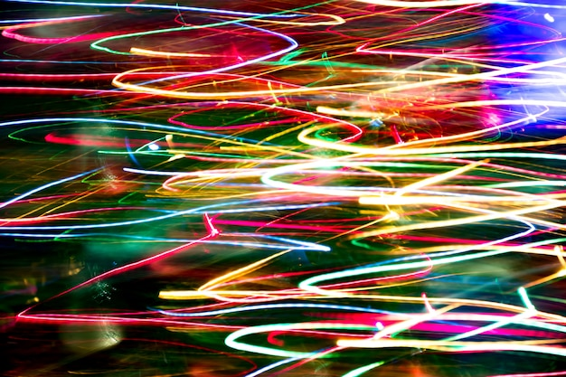 Abstrait texture trouble du mouvement de bokeh coloré. longue exposition de petits néons