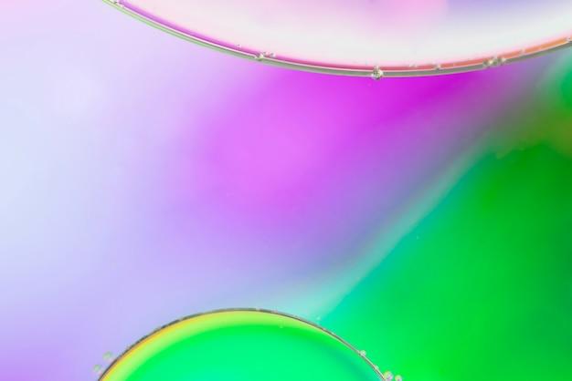 Abstrait vert et rose avec des bulles