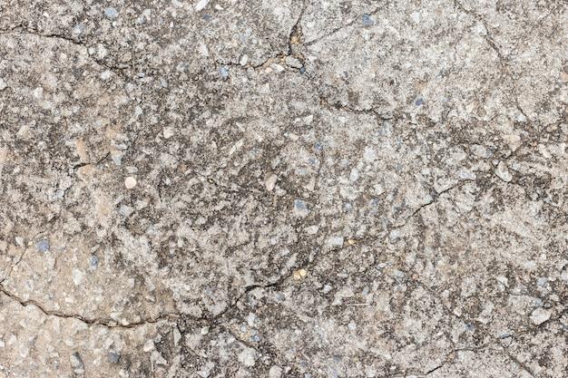 Abstrait vieux mur de ciment sombre sale sur la texture du sol.