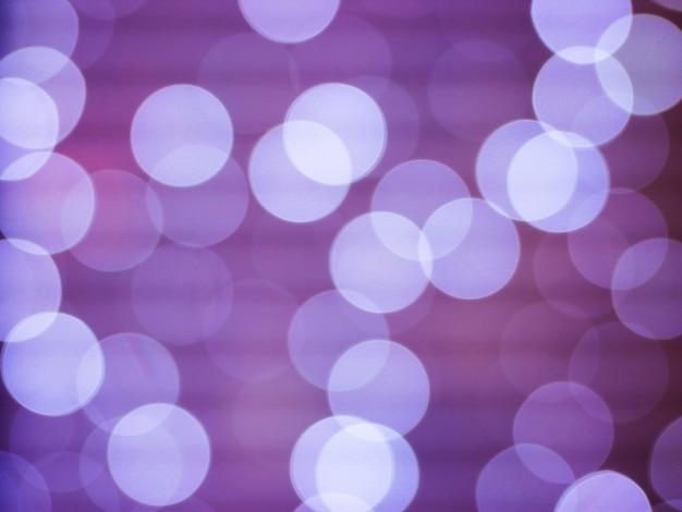 Abstrait violet avec lumières défocalisés bokeh