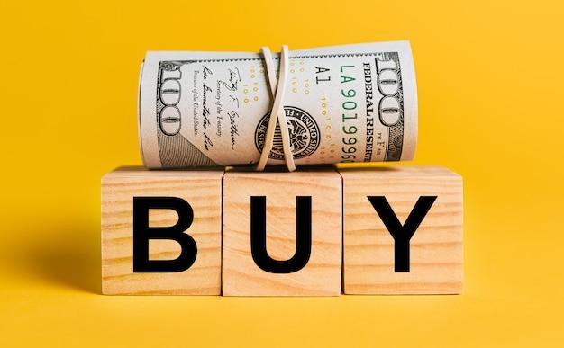 Acheter avec de l'argent sur un espace jaune