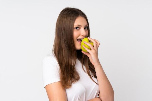 Adolescent, caucasien, girl, isolé, blanc, mur, manger, pomme