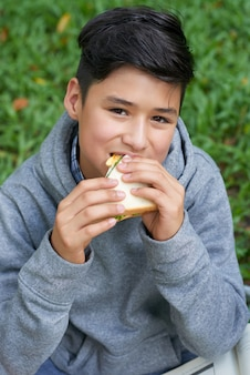 Adolescent, manger, sandwich