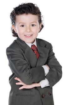Adorable enfant avec des vêtements élégants sur fond blanc
