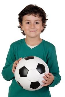 Adorable garçon rêvant d'être joueur de football