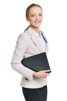 Affaires tenant un cahier