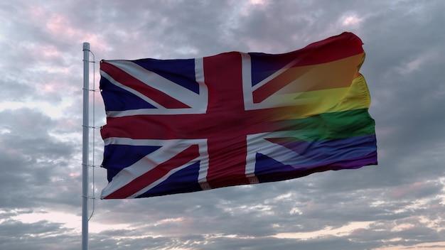 Agitant le drapeau royaume-uni de grande-bretagne et drapeau arc-en-ciel lgbt