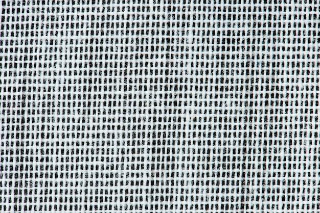 Agrandi de bandes de tissu noir et blanc