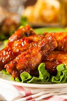 Ailes de poulet grillées aux légumes