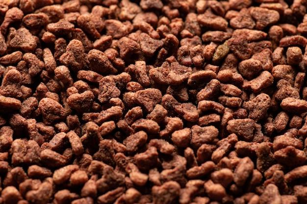 Aliments secs naturels équilibrés pour chats en gros plan vue de dessus de granules