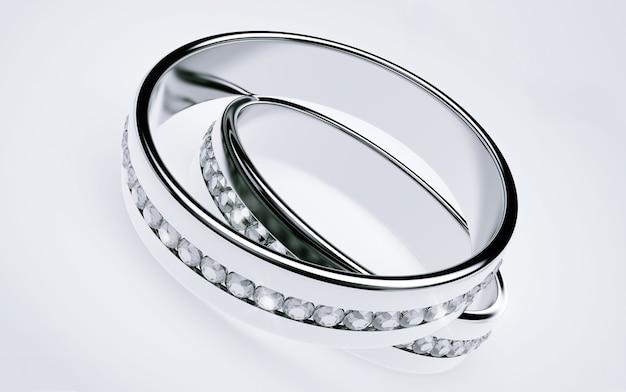 Alliances en platine avec diamants sur fond blanc