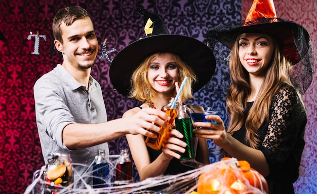 Amis clinking glasses on halloween party