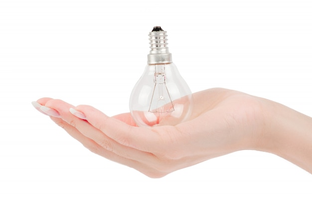 Ampoule allumée tenue en main