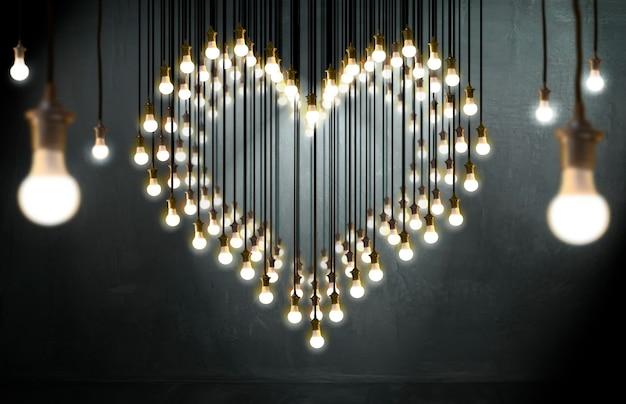 Ampoule coeur, style loft, valentine et concept de l'amour.