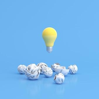Ampoule flottante entre papier froissé sur fond bleu.