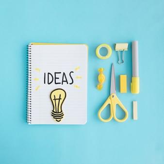 Ampoule d'idées avec stationnaire sur fond bleu