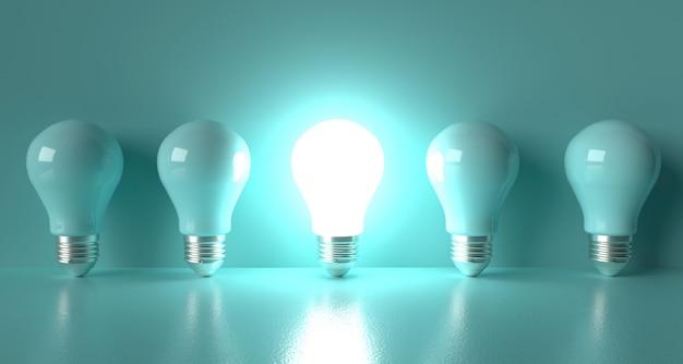 Une ampoule avec une lueur des autres ampoules cyan.