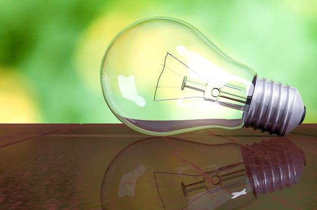 Ampoule sur table en bois avec fond de nature verdoyante et espace pour votre texte, eco