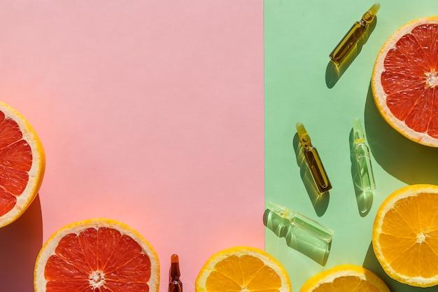 Ampoules avec botox, hualuronique, collagène ou vitamines sur pastel