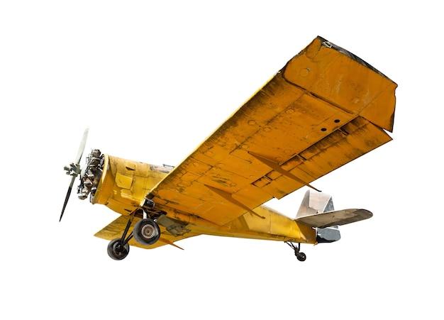 Ancien avion monomoteur isolé sur fond blanc