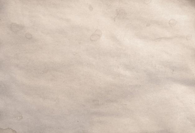 Ancien morceau vierge de fond manuscrit ou parchemin en papier émietté vintage antique
