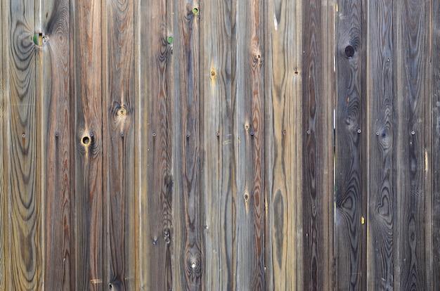 Ancien motif de panneau en bois brun foncé grunge avec une texture de surface magnifique grain abstrait