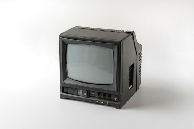 L'ancien téléviseur simple vintage isolé sur fond de couleur, concept minimaliste de l'ancienne mode