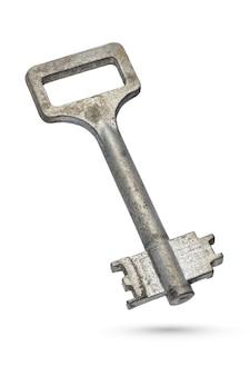 Ancienne clé à levier rouillée isolée sur fond blanc avec un tracé de détourage