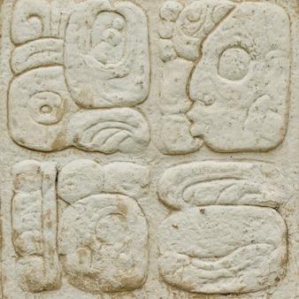 Ancienne écriture Maya Gravée Sur Le Mur De Pierre Photo Premium