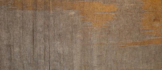 Ancienne feuille de contreplaqué marron pour le fond.