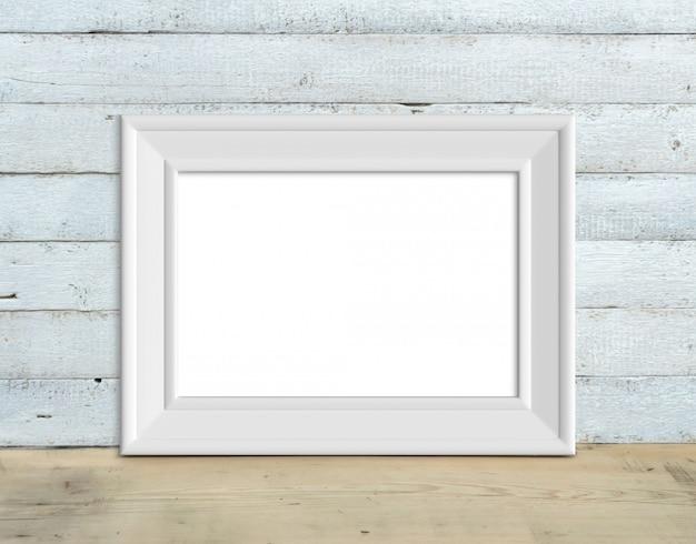 Ancienne maquette de cadre en bois blanc a4 horizontal se dresse sur une table en bois sur un fond en bois peint en blanc. style rustique, beauté simple. rendu 3d.