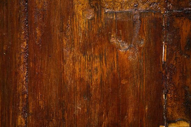 Ancienne porte en bois laqué marron