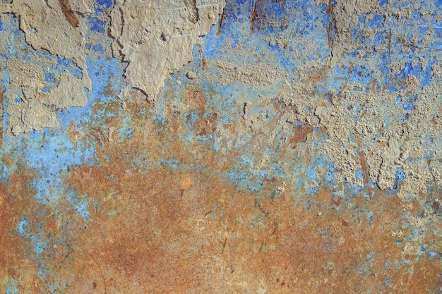 Ancienne surface métallique.métal avec peinture bleue et rouille. texture de vieux métal.