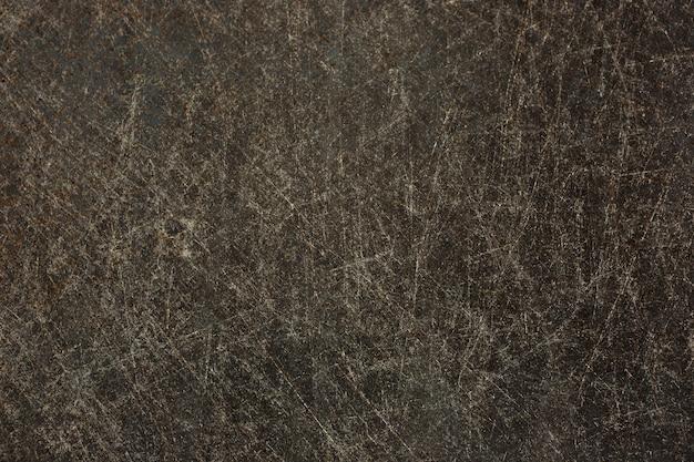 Ancienne surface métallique avec des rayures et de la rouille pour le fond