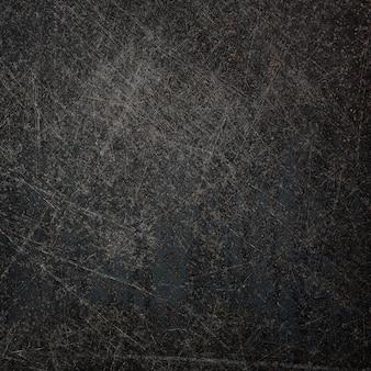 Ancienne surface métallique avec des rayures et de la rouille