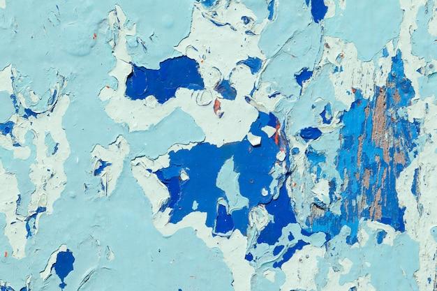 Ancienne texture de peinture bleu clair décollant de fond de planche de bois