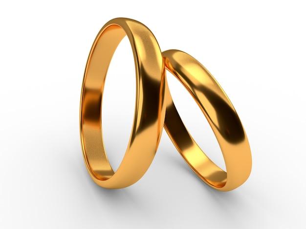 Les anneaux d'or de mariage se trouvent l'un sur l'autre