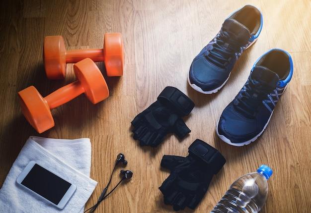 Appareils de fitness sur fond en bois