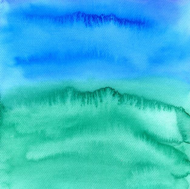 Aquarelle abstraite peint l'arrière-plan. texture colorée dans les couleurs vert, bleu et violet.