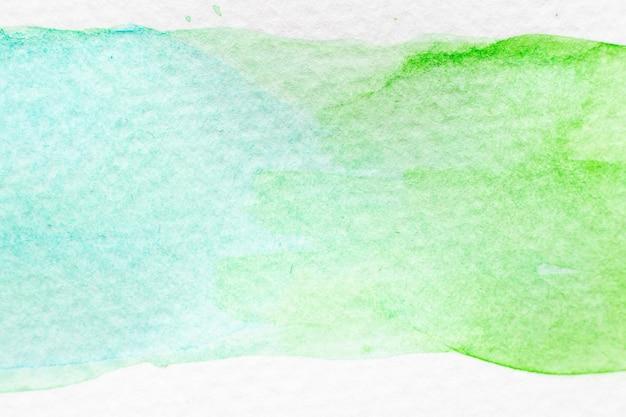 Aquarelle de couleur vert et bleu clair dessiné à la main comme un pinceau ou une bannière
