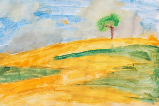 Aquarelle sur toile. champ jaune, herbe verte et ciel bleu
