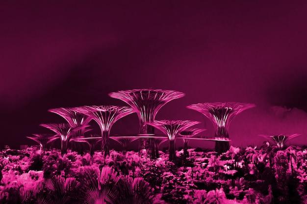 Des arbres violets en fer la nuit à singapour.un paysage fantastique. forêt d'avatar.