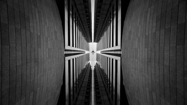 Architecture symétrique avec un avion passant au milieu. photo de haute qualité