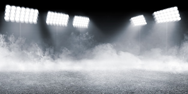 Arène sportive avec sol en béton avec fond de fumées et de projecteurs
